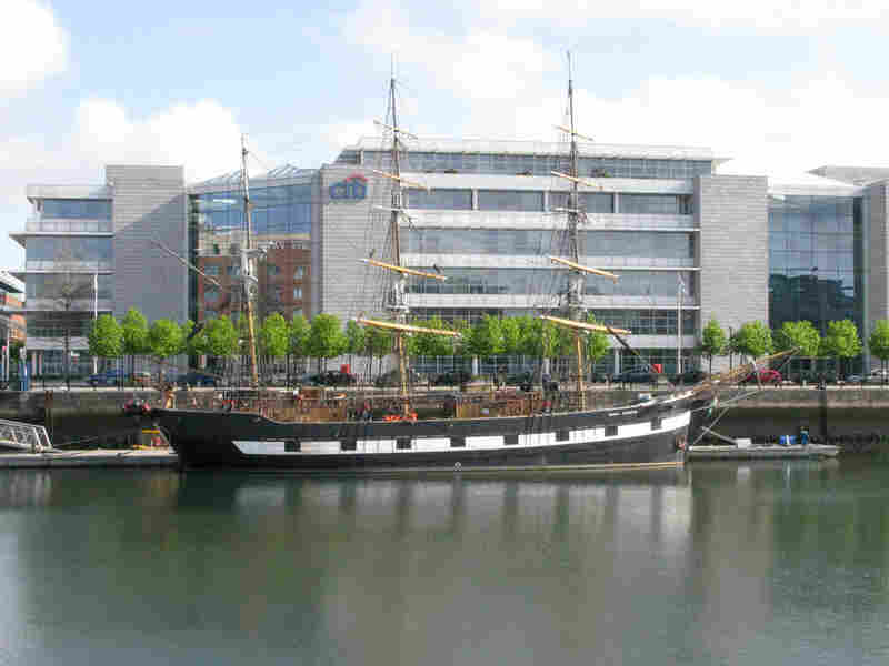 A ship is moored in front of the Citigroup building in Dublin's  Grand Canal area.