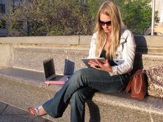"""Leslie Bradshaw displays her iPad and MacBook Air -- some of the wireless devices she carries with her. Bradshaw -- who doesn't have a land line, high-speed Internet or subscription TV at home -- describes herself as a """"digital gypsy."""""""