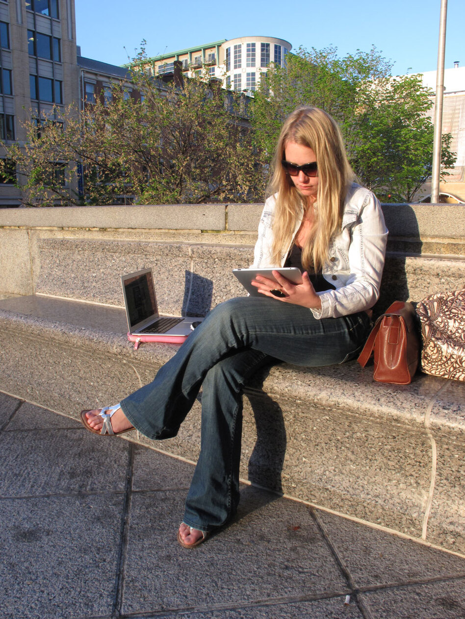 "Leslie Bradshaw displays her iPad and MacBook Air -- some of the wireless devices she carries with her. Bradshaw -- who doesn't have a land line, high-speed Internet or subscription TV at home -- describes herself as a ""digital gypsy."""