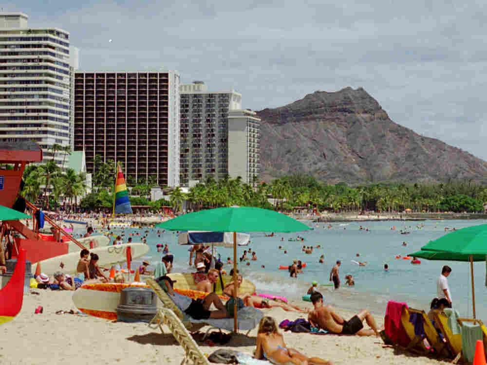 Waikiki Beach, Hawaii, with Diamond Head in the background.