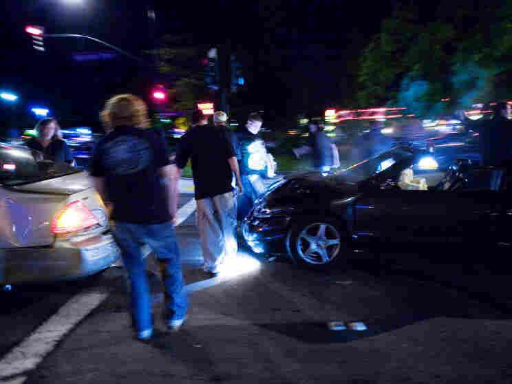 Teens get out of their cars after a crash