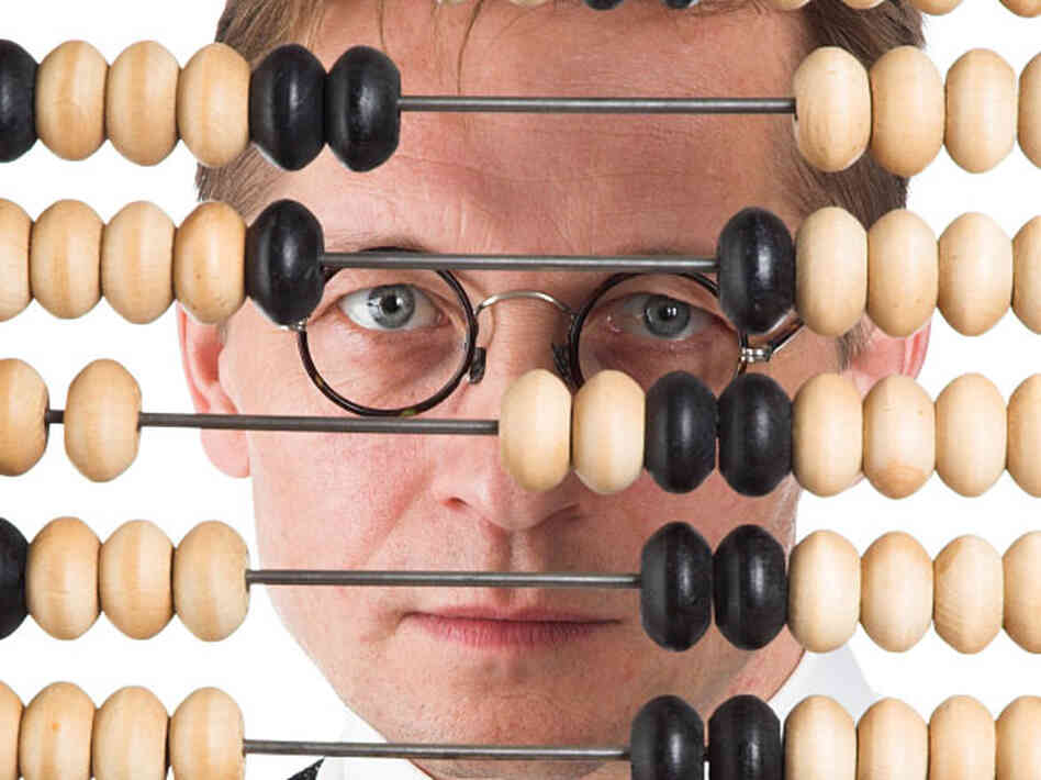 A man peers through an abacus