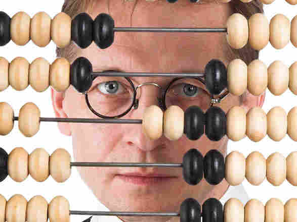 A man peers through an abacus