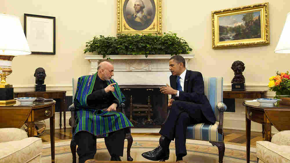 President  Obama speaks with Afghanistan's Hamid Karzai in the Oval Office.