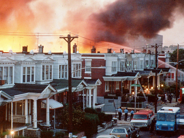 Philadelphia row houses burn in May 1985, after officials dropped a bomb on the MOVE house.