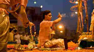 Priests perform the puja in Varanasi, India.