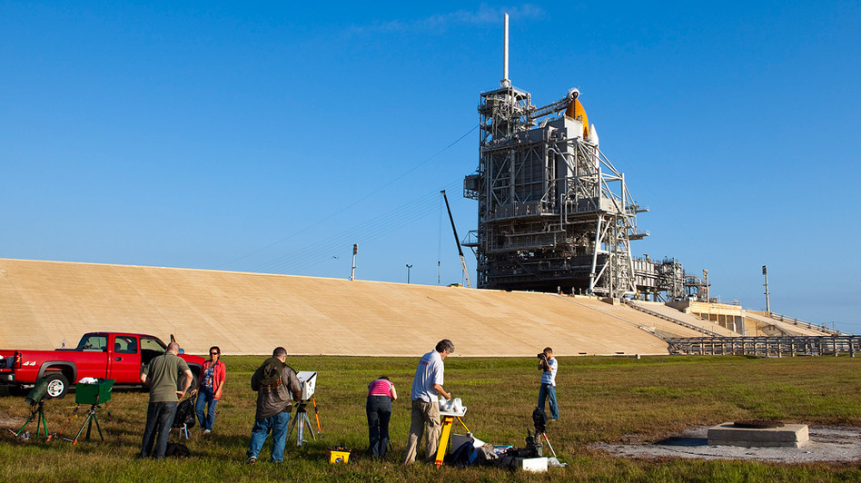 Space shuttle Atlantis awaits blastoff on its launch pad as members of the media set up remote cameras for Friday's scheduled launch from Kennedy Space Center in Florida to the International Space Station.
