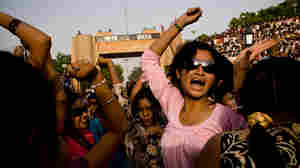 Young women celebrate at the border ceremony.