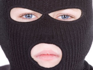 A boy in a ski mask. iStockphoto.com