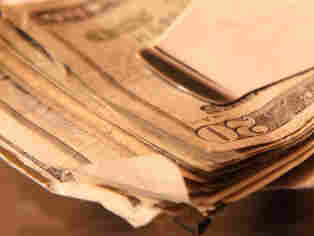 A wad of bills in a money clip. iStockphoto.com