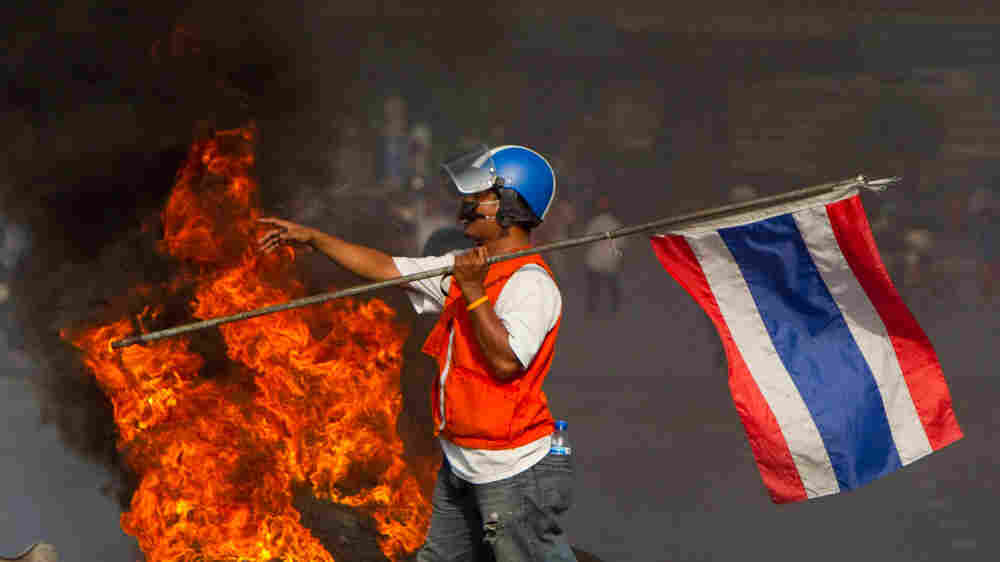 Protester with burning tires in Bangkok