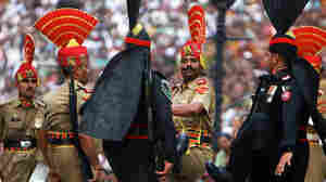 Pakistani Rangers at the Wagah border with India in front of Indian soldiers.