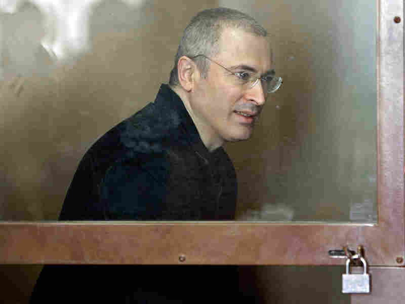 Mikhail Khodorkovsky is locked behind a glass wall in the court room. Misha Japaridze/AP