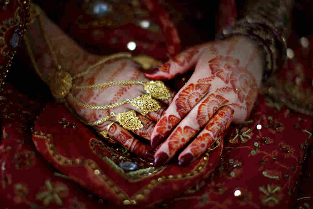 Bride Rukhsana Gul's hands tattooed with henna designs.