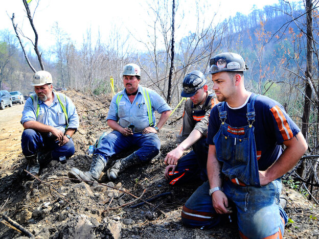 Miners take a break during drilling rescue efforts to save trapped miners after the explosion of the Upper Big Branch Mine. (Getty Images)