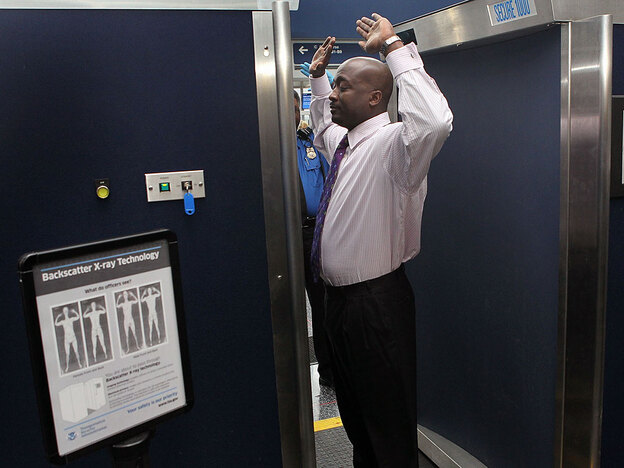 More airports are using back-scatter scanners like this one at O'Hare International Airport in Chicago.