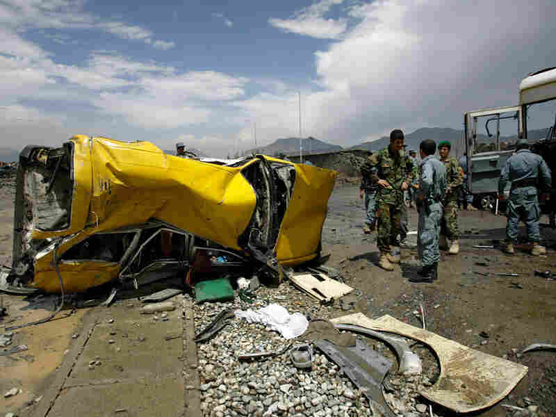 The mangled remains of a vehicle lie at the site of a suicide attack in Kabul, Afghanistan.