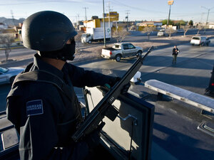 Mexican federal police patrol the streets of Ciudad Juarez