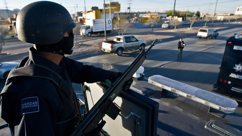 Mexican federal police patrol the streets of Ciudad Juarez during an anti-narcotics operation in March 2009. More than 24,000 Mexicans have died in the country's brutal drug wars since President Felipe Calderon took office in 2006.