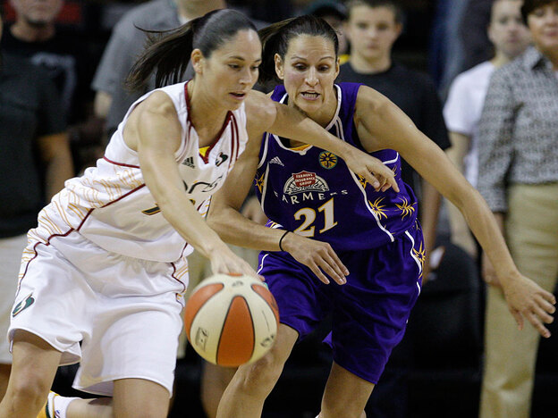 The Seattle Storm's Sue Bird (left) tries to drive past the Los Angeles Sparks' Ticha Penicheiro on Sunday. Bird, a co-captain, says the team has a solid fan base, even if they're not picking up fans of the old SuperSonics NBA team, which moved to Oklahoma City under new ownership.
