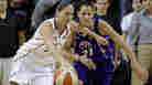 Seattle's Sue Bird (left) tries to drive past Los Angeles Sparks' Ticha Penicheiro Sunday.