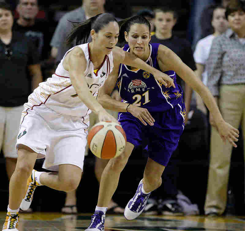 Seattle's Sue Bird tries to drive past Los Angeles Sparks' Ticha Penicheiro