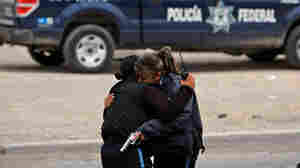 Two officers embrace