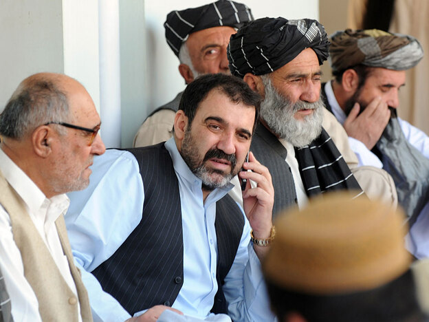 Ahmed Wali Karzai (center, on phone), pictured here last November when his brother Hamid was re-elected president of Afghanistan, is a powerful leader in Kandahar. Chairman of Kandahar's provincial council, he is allied with the U.S. but tainted by accusations of corruption.