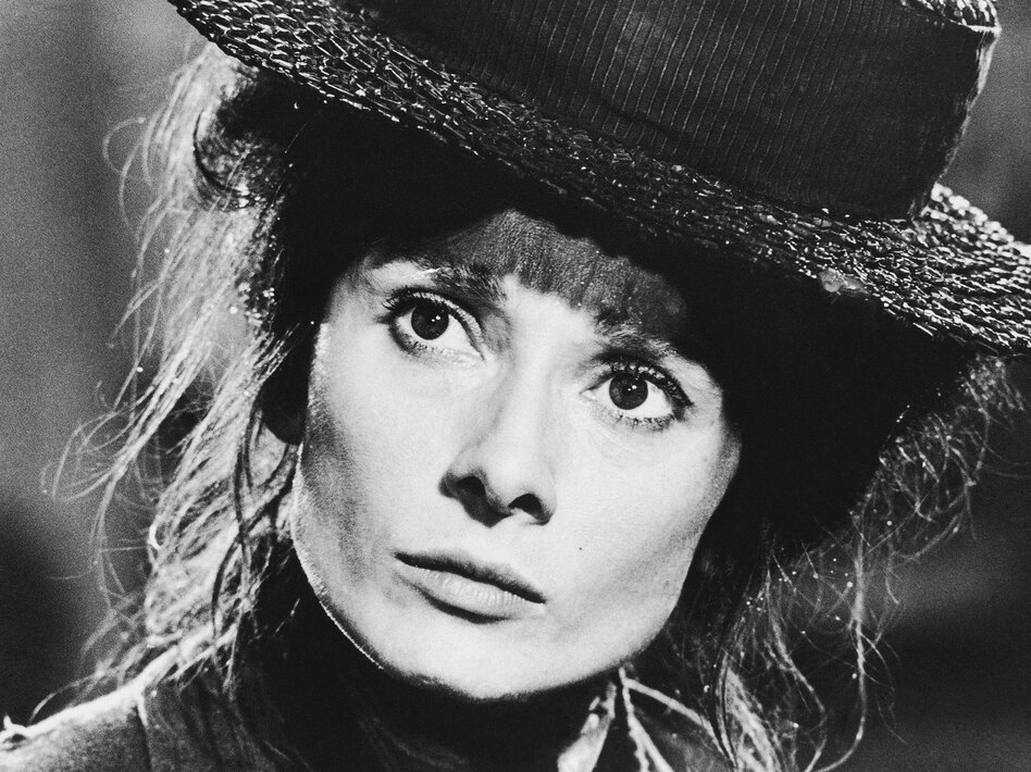 Audrey Hepburn is seen as the flower girl, Eliza Doolittle, in the film version of <em>My Fair Lady</em> in 1964.