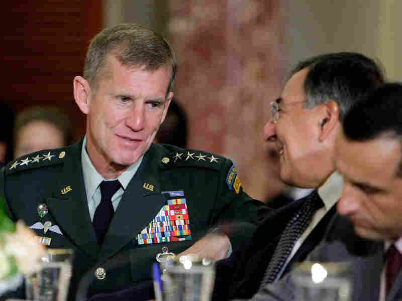 Gen. Stanley McChrystal speaks with CIA Director Leon Panetta.