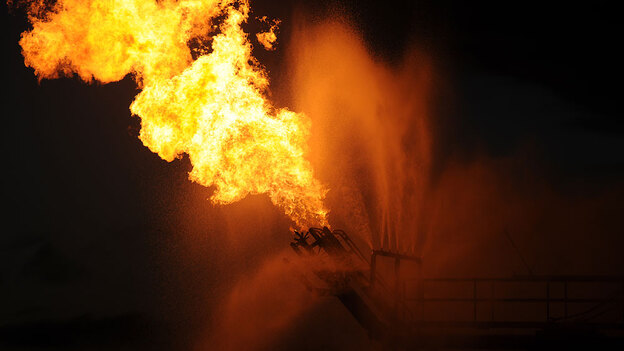 Gas from the damaged Deepwater Horizon wellhead is burned by the drill ship Discoverer Enterprise on Sunday in the Gulf of Mexico off the coast Louisiana. (U.S. Coast Guard via Getty Images)