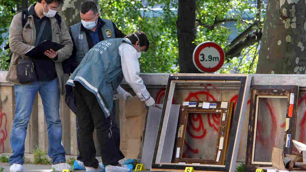 Police officers packed up the frames of stolen paintings at the Paris Museum of Modern Art.