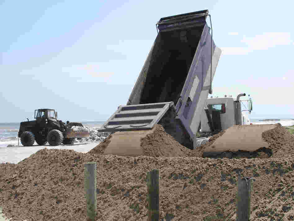 National guard troops move sand and boulders at Port Fourchon.