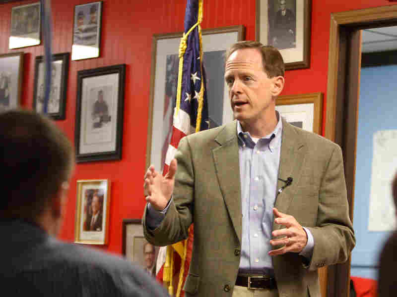 Pat Toomey  talks with supporters at the party office in Johnstown, Pa.