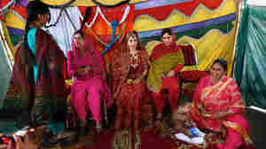 On her wedding day, bride Rukhsana Gul sits with some of her nine sisters.