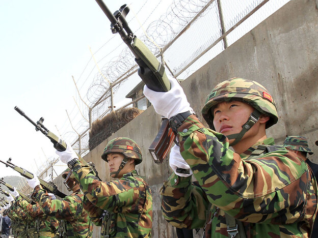 South Korean marines provide a gun salute at their base on Baengnyeong Island on April 29 to honor the 46 sailors killed when the warship Cheonan sank.