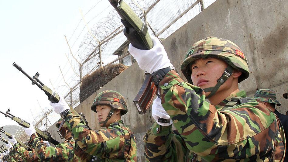 South Korean marines provide a gun salute at their base on Baengnyeong Island on April 29 to honor the 46 sailors killed when the warship Cheonan sank.