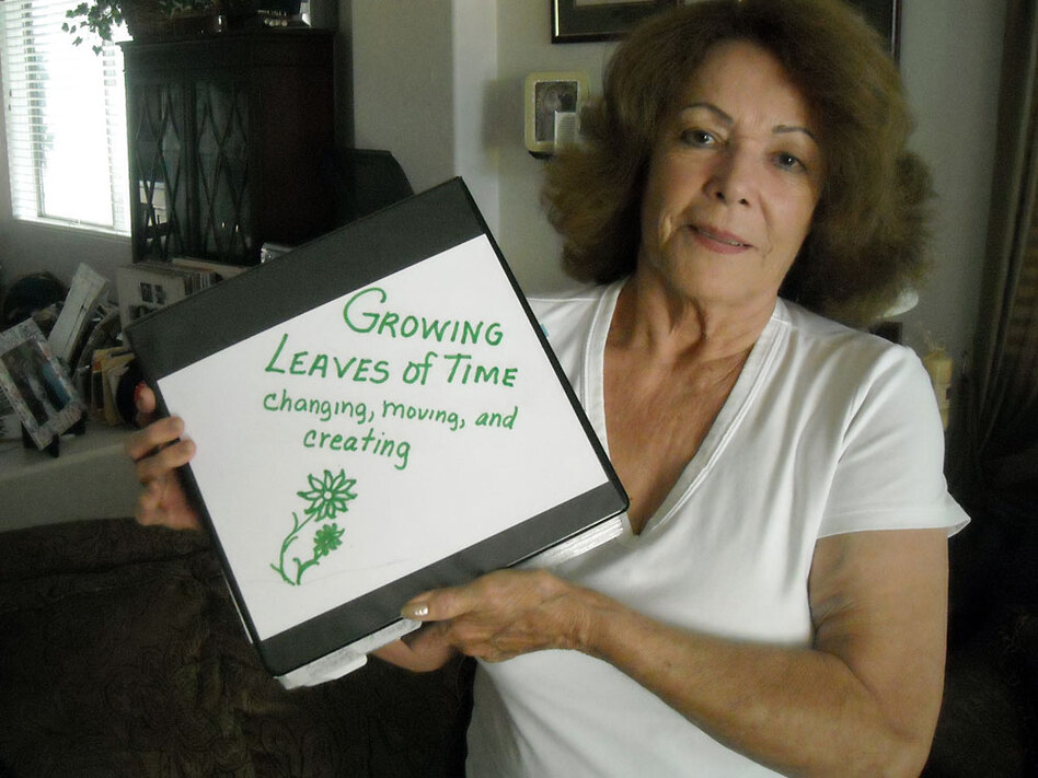 Mary Marin holds a scrapbook of photos from her childhood in a South Phoenix barrio. Her father was an illegal immigrant and was threatened with deportation in the 1940s. Still, Marin favors Arizona's tough new law against illegal immigration.