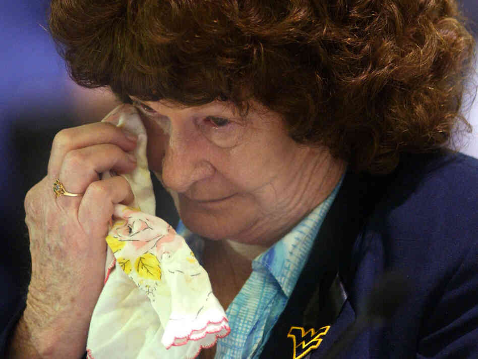 Alice Peters wipes away a tear during her testimony