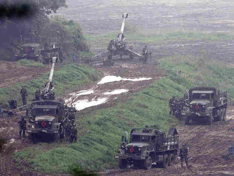 South Korean artillery soldiers take positions during drills near the demilitarized zone.