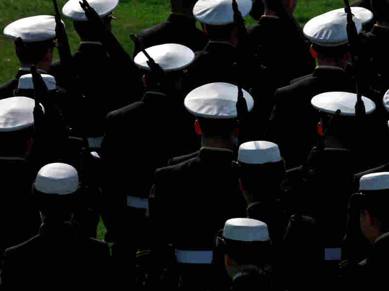 The Brigade of Midshipmen marches in a formal dress parade at the U.S. Naval Academy.
