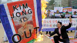 South Korean man burning flag