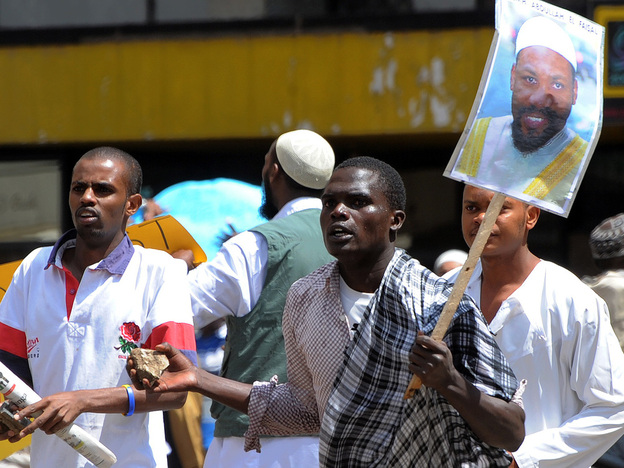 Kenyan Muslims in Nairobi carry posters of Jamaican cleric Abdullah Faisal and throw stones at police during a Jan. 15 demonstration demanding Faisal's release from Kenyan custody. U.S. intelligence officials say Faisal was recruiting for al-Shabab, a Somali Islamic militia with links to al-Qaida. Faisal denies the allegations. He was eventually returned to Jamaica from Kenya.