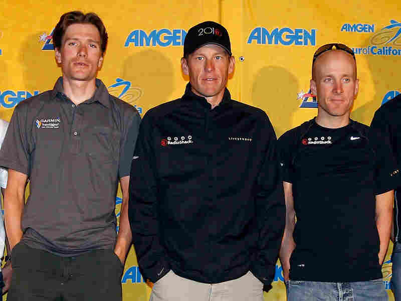 David Zabriskie, Lance Armstrong, Levi Leipheimer at a press conference.