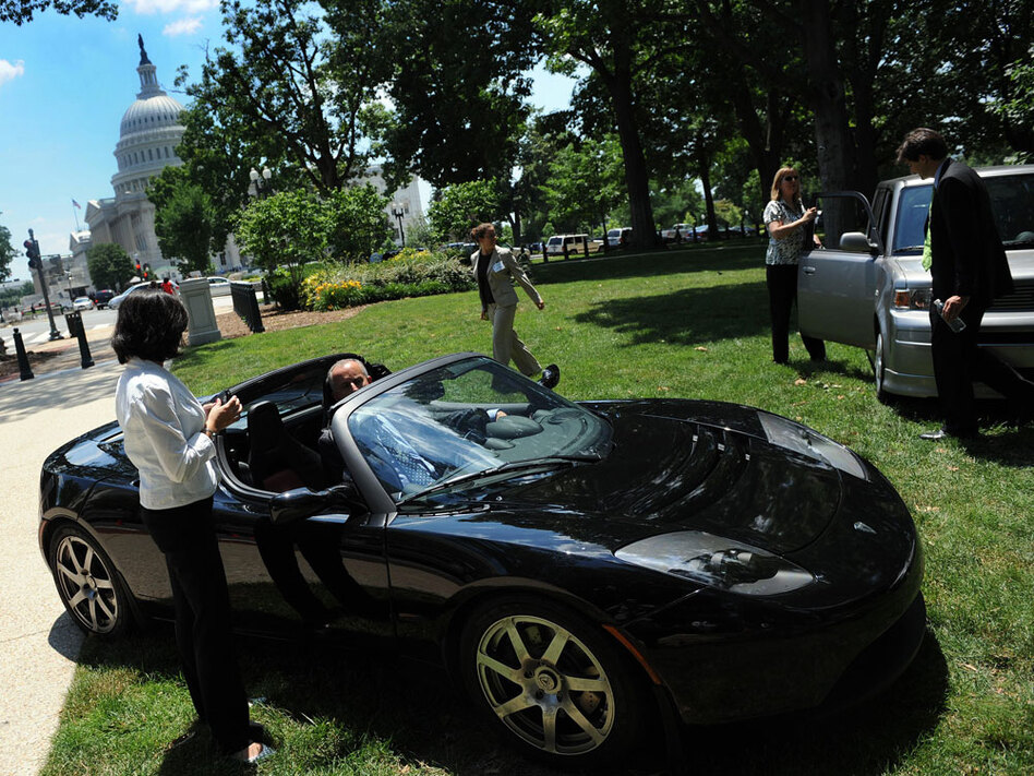The Tesla Roadster, an electric sports car, sits on display in Washington, D.C., during a showcase of new automotive technologies in 2008. Tesla now plans to build a Model S family sedan and other electric vehicles with Toyota in the NUMMI plant in Fremont, Calif.