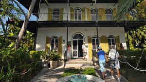 Visitors enter The Ernest Hemingway Home & Museum in Key West, Fla.