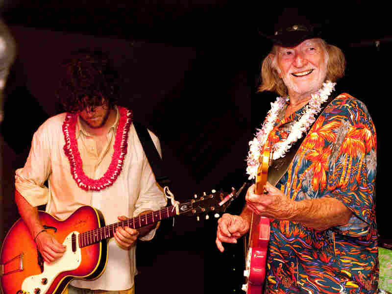 Country singer Willie Nelson (right) performs with his son Micah Nelson's band, The Reflectacles