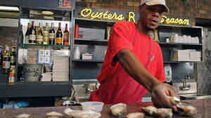 Kenneth Williams shucks oysters at Felix's Restaurant in New Orleans at the end of April.