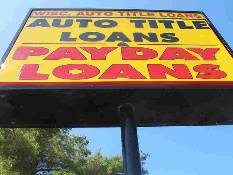 A sign for an auto title loans store is shown in Madison, Wis.