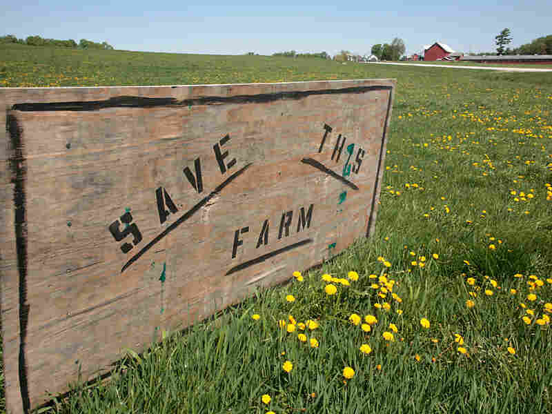 A sign defends the Rainville's farm
